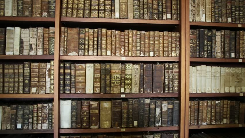 Coimbra, Portugal - August 14, 2017: wooden shelf with historic, decorated, vintage books at University of Coimbra, Europe's oldest university. Background of books.