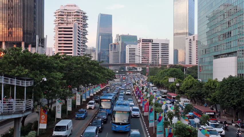 JAKARTA, INDONESIA - OCTOBER 22, 2017: Cars and buses stuck in a traffic jam in Jakarta business district during rush hour. Jakarta, Indonesia capital city is famous for being very congested.