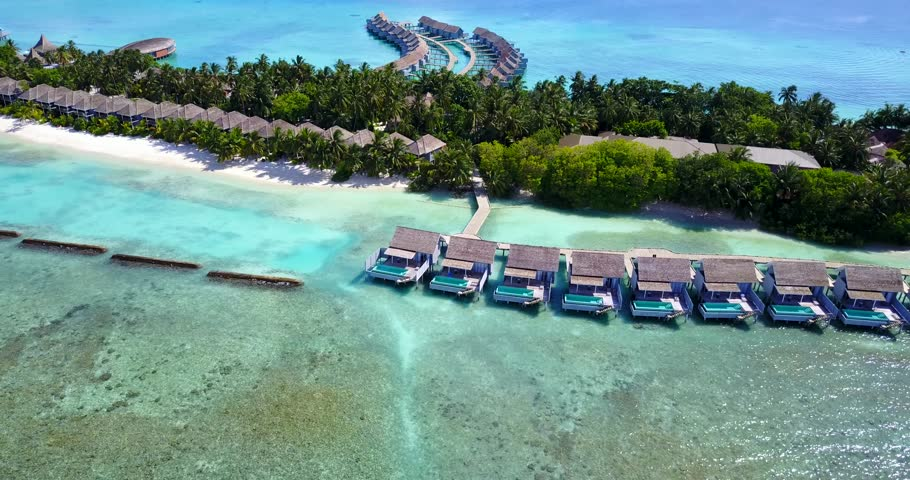 v09516 five 5 star resort water bungalows in Maldives with drone aerial flying view on white sand beach on tropical island