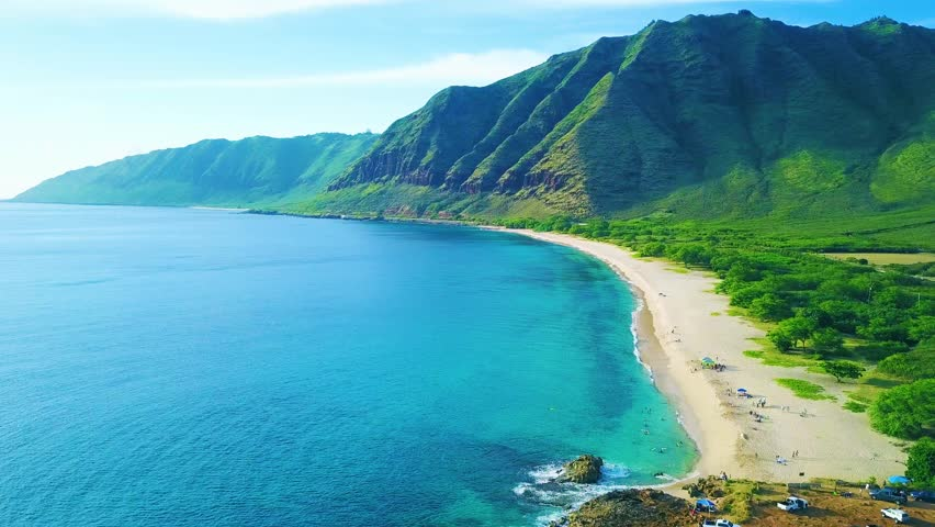 Tropical Hawaiian Beach with Blue Ocean, Green Rainforest Mountains.  Secluded Hidden Beach in Paradise. Pray for Sex / Pray for Sets Beach - Blue sky, turquoise calm ocean water waves.  Oahu Hawaii. | Shutterstock HD Video #32197276