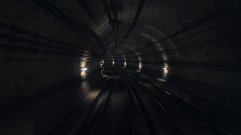 Timelapse View of subway tunnel from the rear of moving backward train. Fast underground train riding in tunnel of modern city.Long footage of underground train in Barcelona following its route. 4k