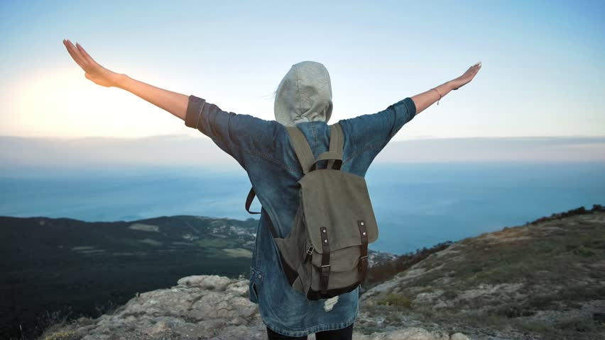 Woman traveler with backpack walking and enjoying view at mountains. | Shutterstock HD Video #32229826