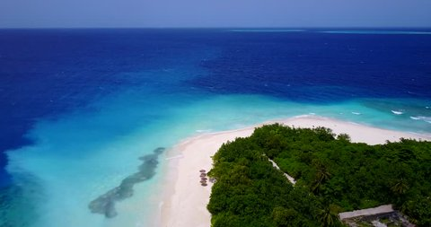 v11763 maldives white sand beach tropical islands with drone aerial flying birds eye view with aqua blue sea water and sunny sky