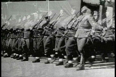 CIRCA 1930s - A brief explanation of Italys close relationship with Japan during World War II, including close-up footage of Mussolini and a huge stadium rally attended by senior members