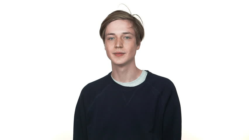 portrait of teenage boy in braces being excited ecstatic expressing delight behaving like winner isolated over white background closeup in slow motion. Concept of emotions