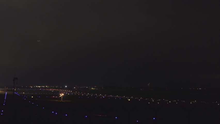 The Plane Takes Off From Airport In Night
