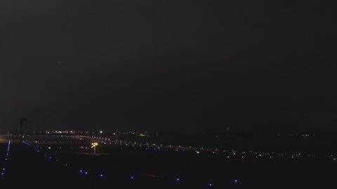The plane takes off from the airport in the night