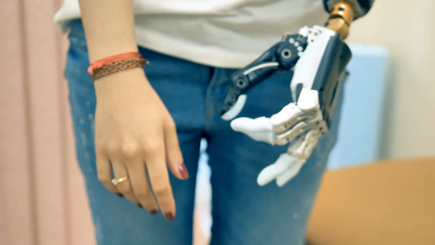 Disabled woman demonstrates her bionic hand. 4K. | Shutterstock HD Video #32297056