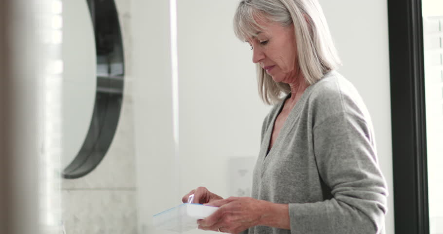 Senior woman taking medicine | Shutterstock HD Video #32305846