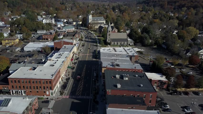 Scenic Village, TRACKING, Great Barrington MA Low AERIAL, sunny day.