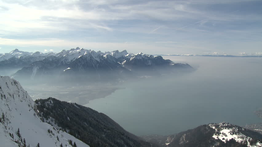 Amazing high altitude view over Lake Geneva in Switzerland shot from about 6,500ft. Includes inversion layer of haze trapped at lower altitude. Shot in full HD 1920x1080 30p on Sony EX1