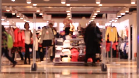 Shoping in mall, walking people, blurred background.