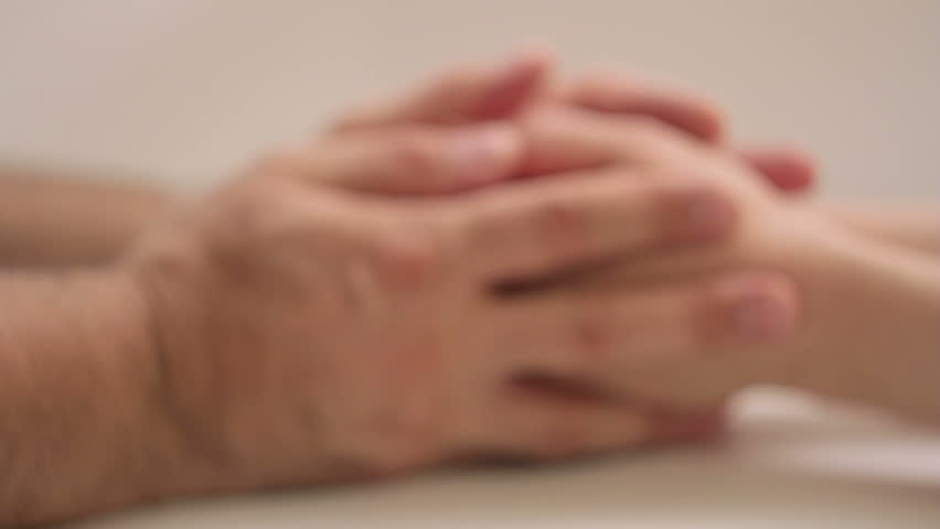 A man and a woman hold hands by gently touching and stroking. Close-up, out of focus   Shutterstock HD Video #32439946