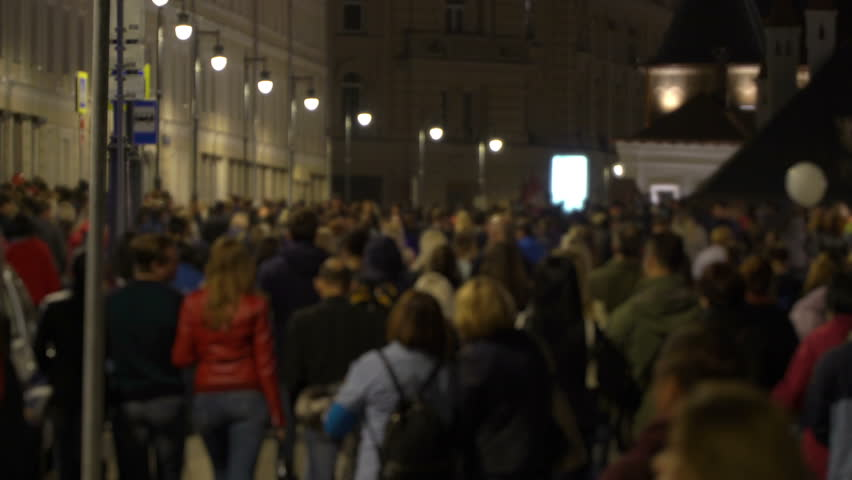 Unrecognizable crowd of people walking around night city in light of street lamps. People with families go home after fireworks. Concept of celebration and good mood. | Shutterstock HD Video #32465572
