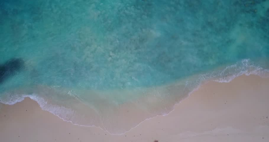 V14070 waves water texture breaking and crashing with drone aerial flying view of aqua blue and green clear sea ocean   Shutterstock HD Video #32500156