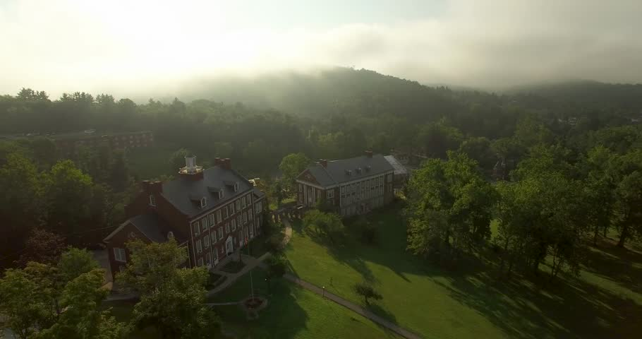 Gorgeous panoramic views of the Davis & Elkins College campus on a warm morning with fog. Liberal Arts Hall is the centerpiece for this aerial.