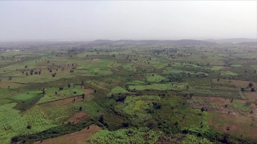 Aerial footage of open green farm lands in Abuja Nigeria