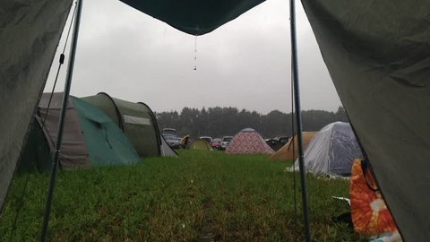 Tent lookout during rain on a camp.