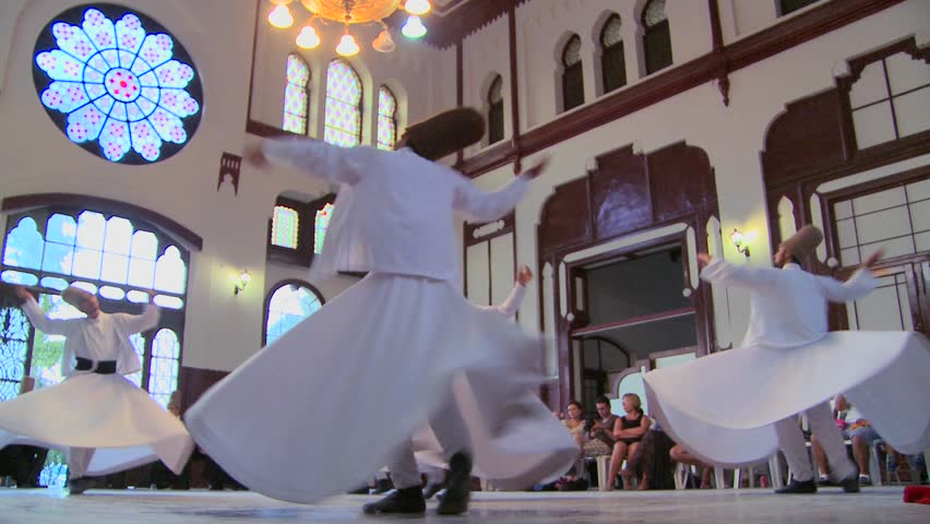 ISTANBUL, TURKEY - CIRCA 2012: Whirling dervishes perform a mystical dance in Istanbul, Turkey.