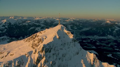 WS AERIAL Communications tower on top of snowy mountain / Wilder Kaiser, Kitzbuhel Alps, Tyrol, Austria