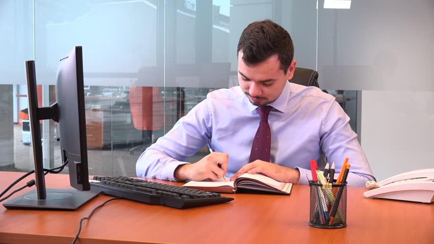 Well dressed young businessman answering desk phone joyful confident worker job | Shutterstock HD Video #32566816