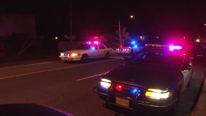 PORTLAND, OREGON - CIRCA DECEMBER 2012: Police lights flashing at night downtown
