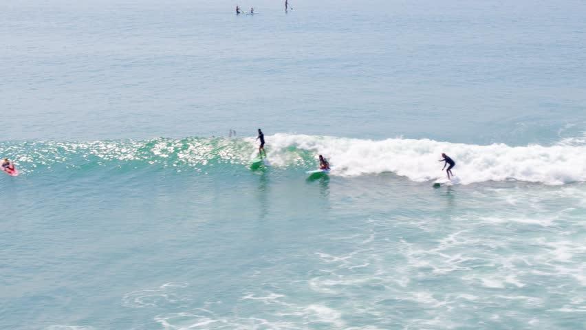 Aerial Drone Stock Video longboard Surfers in Malibu on sunny day