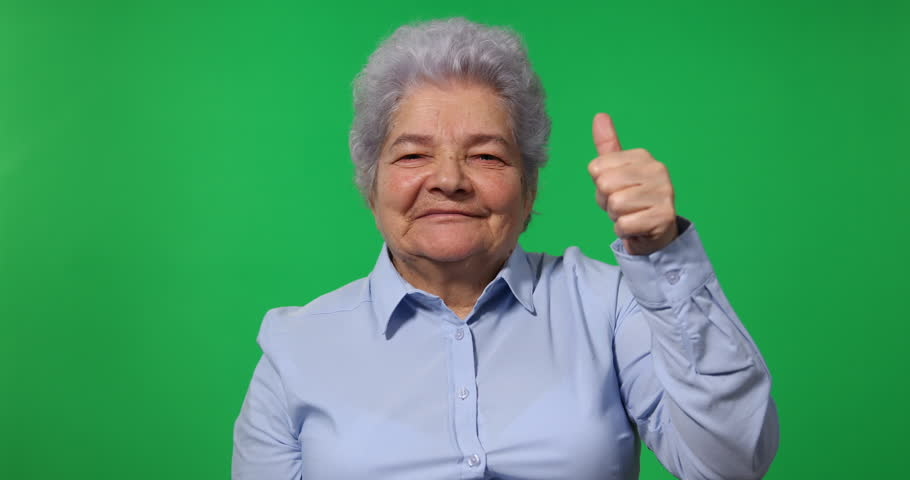 Happy Old Business Woman Showing Thumb Up Sign to Camera Green Screen Background | Shutterstock HD Video #32575786