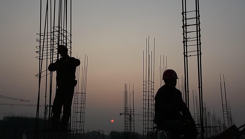 Worker working with concrete reinforce iron near sunset | Shutterstock HD Video #3259336