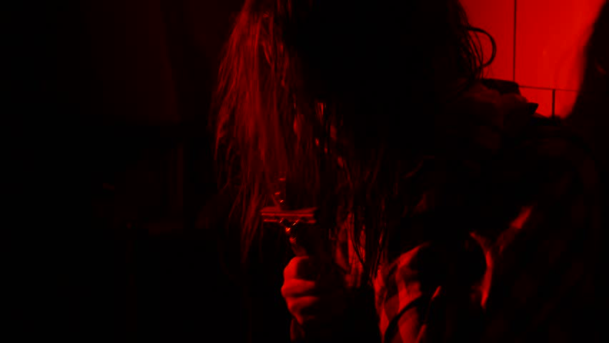 Teen girl with crucifix afraid in the dark. | Shutterstock HD Video #32706439