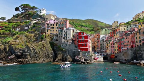 First city of the Cique Terre sequence of hill cities - Riomaggiore. Colorful morning view of Liguria, Italy, Europe. Great spring seascape of Mediterranean sea. Full HD video (High Definition).