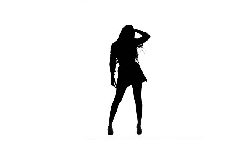 Woman is dancing a sexy dance. Silhouette. White background