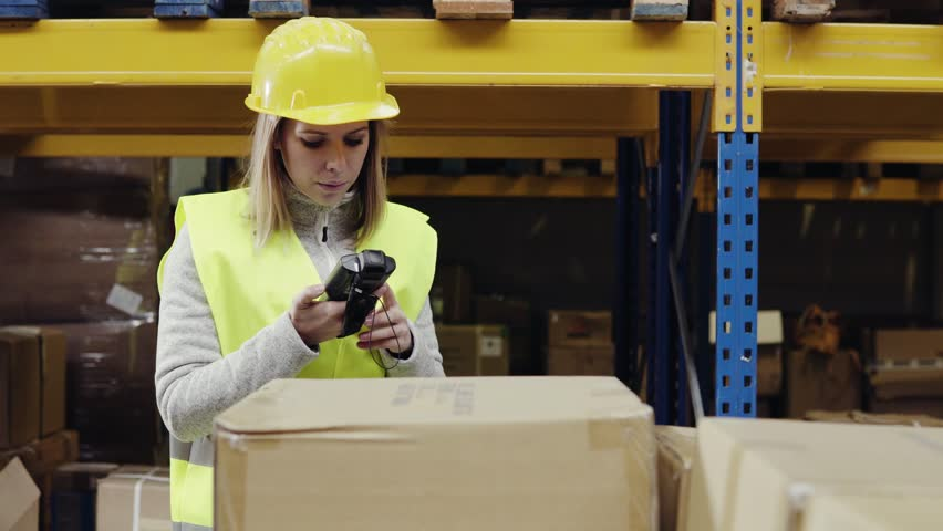 Female warehouse worker with barcode scanner. | Shutterstock HD Video #32787646