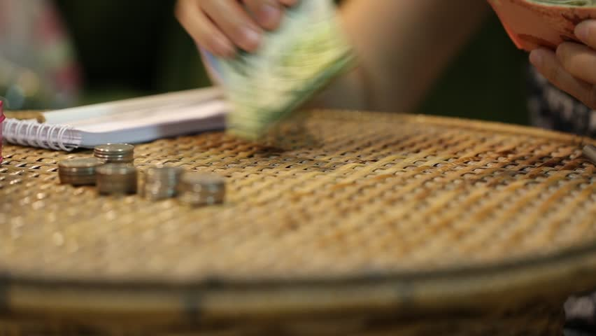 Woman hand counting money closeup on table blur background | Shutterstock HD Video #32816824