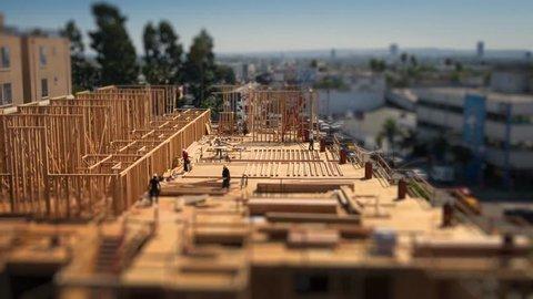 Workers building construction site Los Angeles Tilt shift miniature timelapse, 4K UHD