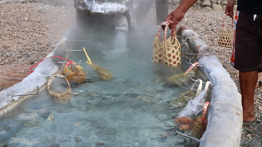 Eggs in the basket are boiled in hot springs at sankamphaeng hot springs chiangmai,Thailand   Shutterstock HD Video #32823457