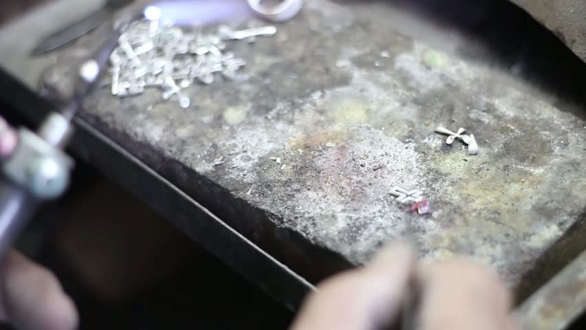 Soldering of silver, Manufacture of carved articles from silver by hands, handwork on silvers in Armenia, decoration of manual production of silverware.Armenian silver production, man worked. UHD.