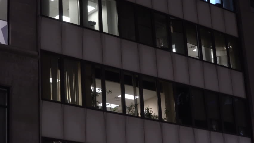 NX Night time establishing shot urban city office or apartment building exterior. Lights on through windows on skyscraper facade. Day / Night matching shot | Shutterstock HD Video #32837206