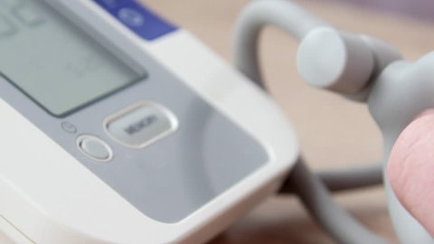 Doctor measuring the blood pressure of the patient. He found symptoms of hypertension: high blood pressure and high pulse. 4K UltraHD video