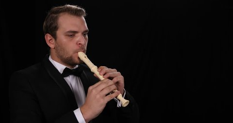Portrait of Musician Flutist Man Playing Recorder Flute Classic Music Orchestra