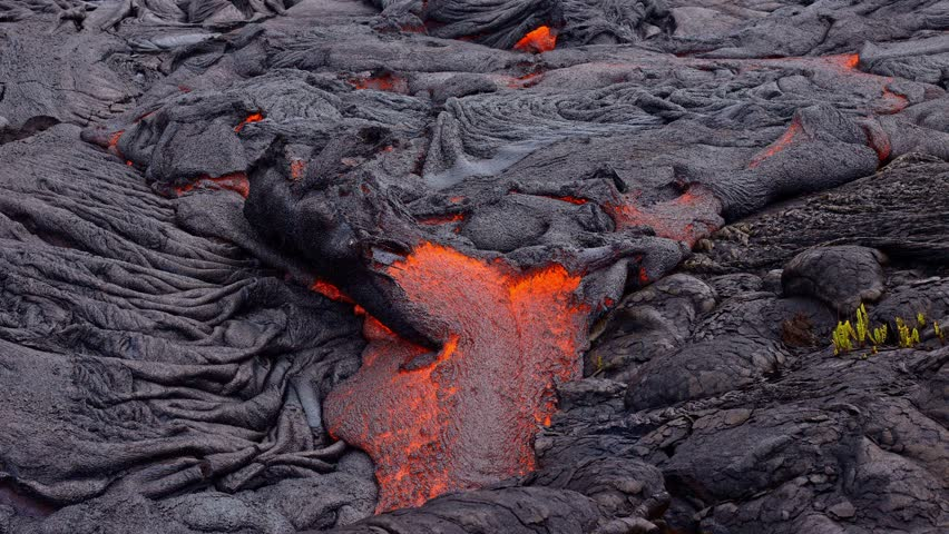 Flowing lava breakout time lapse Day daytime Glowing Hot flow from Kilauea Active Volcano Puu Oo Vent Active Volcano Magma