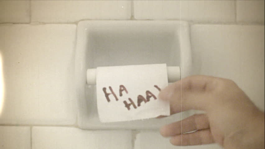Fake 8mm amateur film: grabbing the last strip of paper from a toilet roll and discovering a mocking notice written in red ink.  | Shutterstock HD Video #32866522