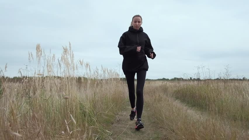 blondie sports the on runner on practice camera runs road jog running nature morning on training tracksuit athletic black in 18qXpd