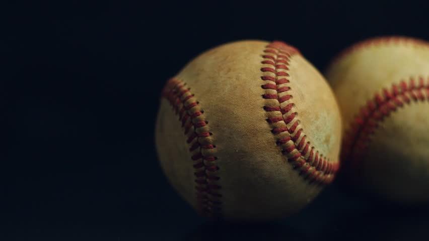 Two Baseballs On Black Background
