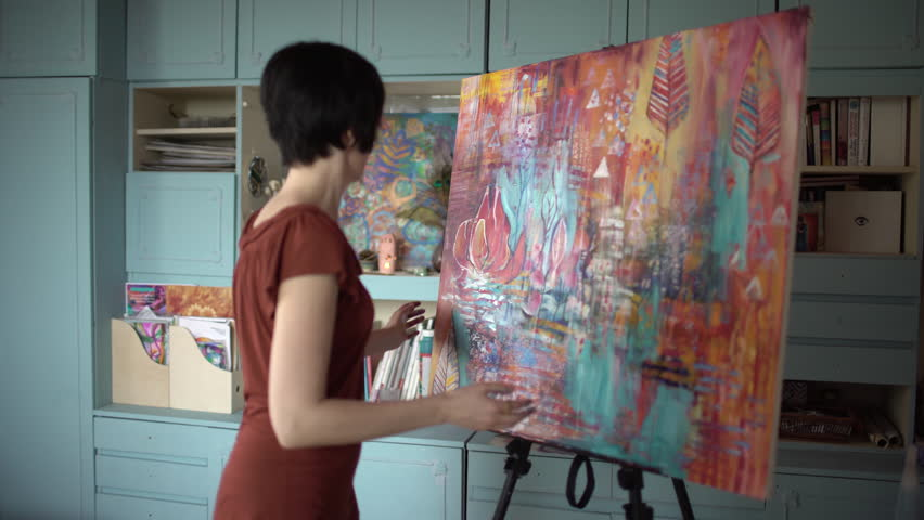 Woman artist painting an abstract painting of the hands in the art studio. Side view. 4 k | Shutterstock HD Video #32898826