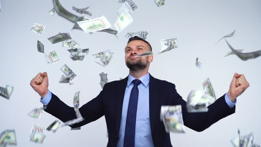 Slow motion of dollars falling on formally dressed man | Shutterstock HD Video #32912161