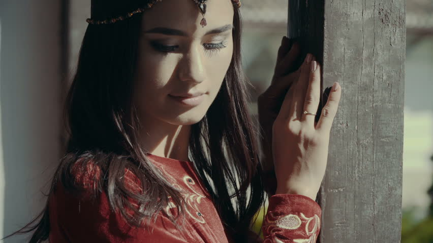 Portrait of Smiling Beautiful Muslim Girl. Traditional Red Tatar Costume