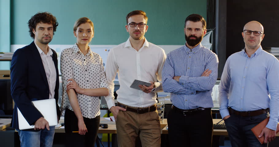 Portrait shot of smiled multi-ethnical business team posing in the modern office. Male and female office workers. Indoor | Shutterstock HD Video #32952355