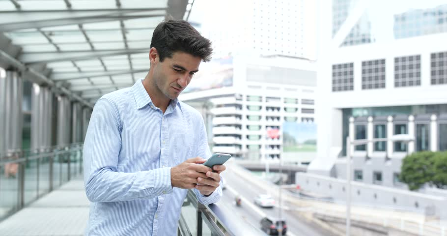 Man use of mobile phone in city | Shutterstock HD Video #32960116