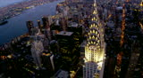 New York - August 20, 2012: Aerial illuminated Chrysler Building Hudson River dusk